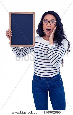 Surprised Asian woman holding blackboard on white screen