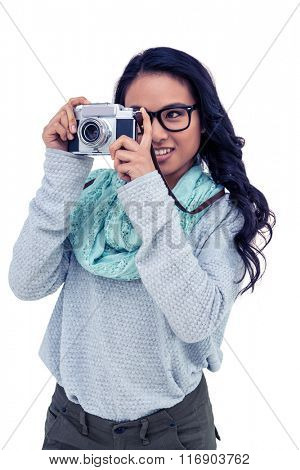 Asian woman taking picture with digital camera on white screen