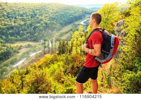 Men walk along the hill with backpack