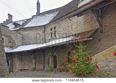 View To Inside Court Of Chillon Castle With Christmas Tree