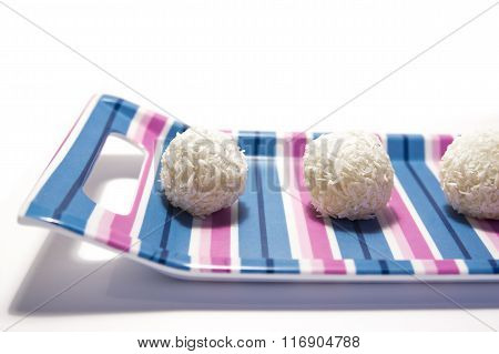 isolated white chocolate balls with coconut