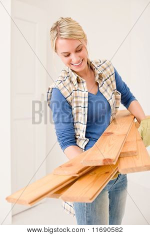 Home Improvement - Handywoman Carry Wooden Plank