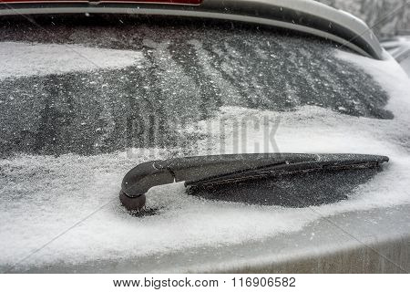 Car's Window Frozen And Covered With Snow In The Winter Day