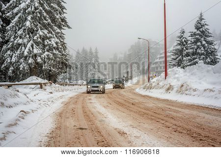 Winter Road With Cars And Fog