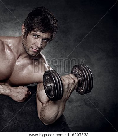Young Muscular Sexy Man Workout In Gym