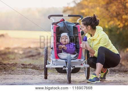 Young mother running