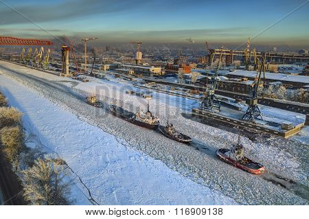 Aerial View Of Ice-covered Sea Canal Cargo Port Of Saint Petersburg.