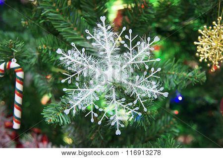 Snowflake Decorated On Christmas Tree