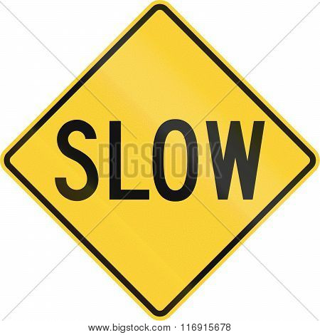 Road Sign In The United States Warning Drivers To Proceed Slowly Or Slow Down