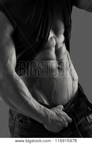 Muscular male torso, shirt and jeans. Black and white image