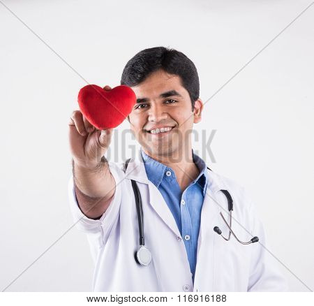handsome indian doctor holding heart stuffed toy, doctor with red heart, asian doctor and heart care