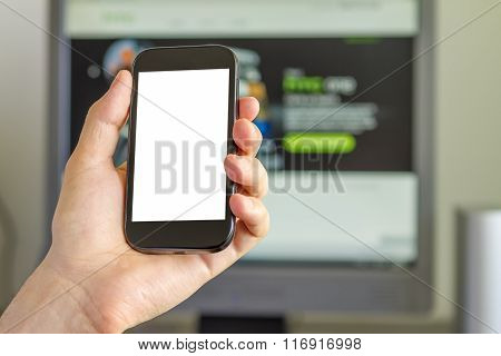 Closeup Of Man's Hand Holding A Smartphone