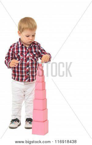 Boy builds a pyramid
