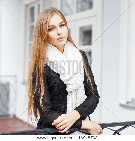 Young Beautiful Girl With A Warm Knitted Scarf Standing On The Porch Of Vintage Homes