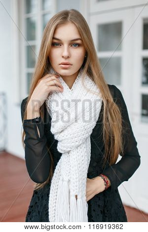 Fashionable Stylish Girl With A White Scarf Is A Warm On The Background Of Retro Building