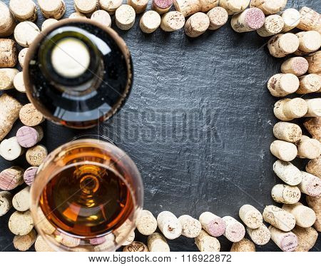 Wine corks arranged as frame on the graphite board.