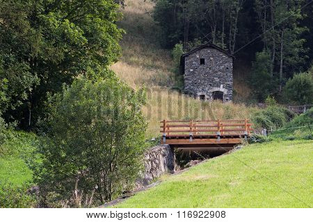 Mountain Meadow With House