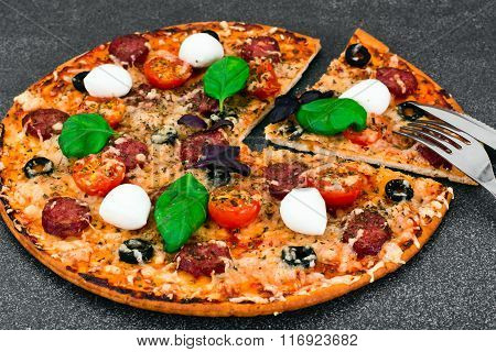 Pepperoni Pizza with Sausage, Cheese, Mozzarella, Olives and Bas