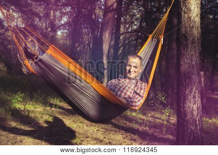 Happy Man Relaxes,  Lying In A Hammock