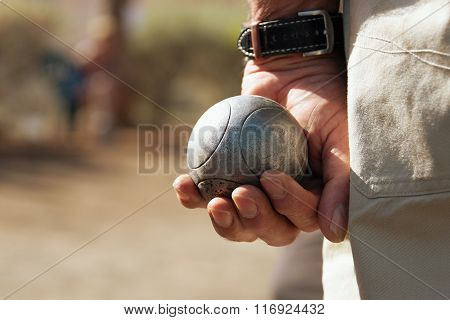 Senior playing petanque