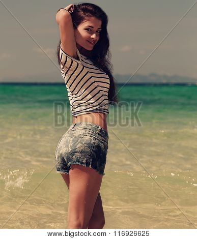 Beautiful Smiling Woman Posing On Sea Background In Blue Shorts And Top. Toned Closeup Portrait