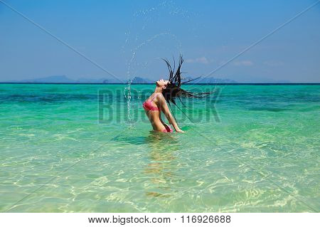 Beautiful Model Woman Splashing Her Hair In Turquoise Azure Water In Pink Bikini