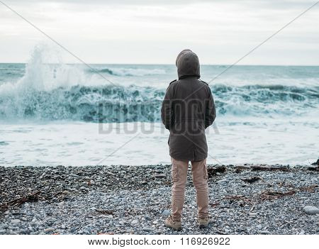 Traveler Looking At Sea Waves