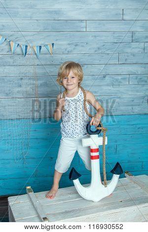 child holding anchor