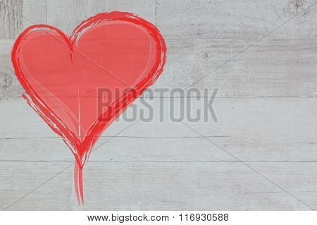 red heart on the background of wood texture