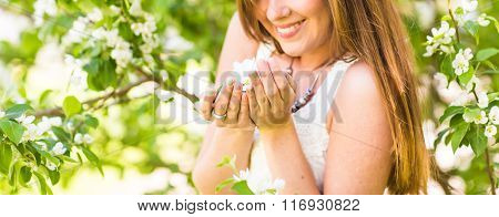 woman in the spring garden among apple blossom