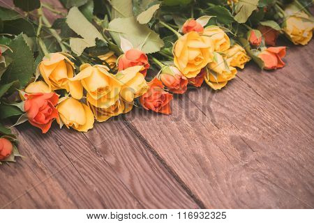 Yellow And Orange Roses On A Wooden Background. Women' S Day, Valentines Day, Mothers Day.