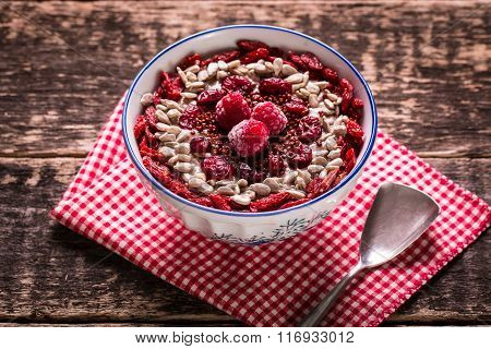 Breakfast banana smoothie bowl topped with goji berries,raspberry