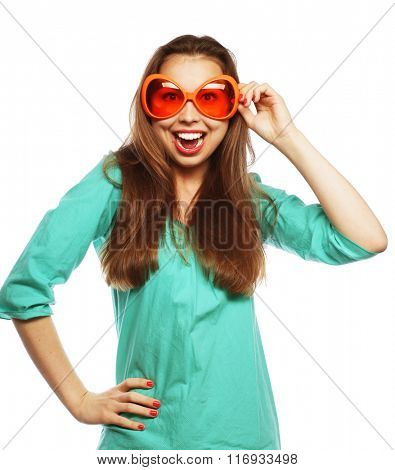 Playful young woman with party glasses. Ready for good time.