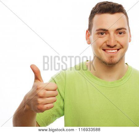 young man in green shirt  showing thumbs up.