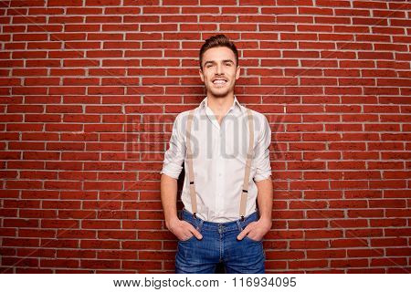 Portrait Of Pretty Man Holding Hands In Pockets