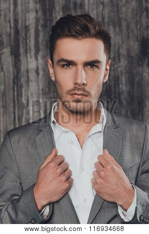 Attractive Man In Suit On The Grey Background