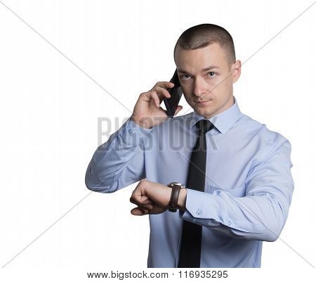 Businessman Talking On The Phone And See Clock