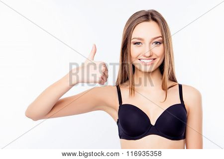 Young Sexy Woman In Black Bra Thumbs Up