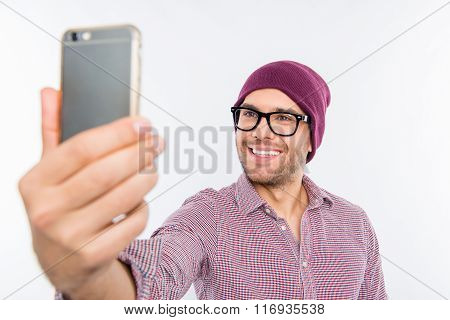 Smiling Man In Cap And Glasses Making Selfie