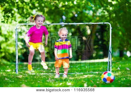 Kids Playing Football In School Yard