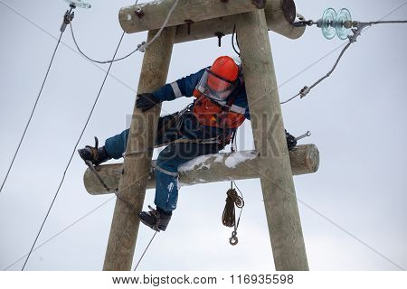 Electrician Working On Top Of An Electricity Pylon
