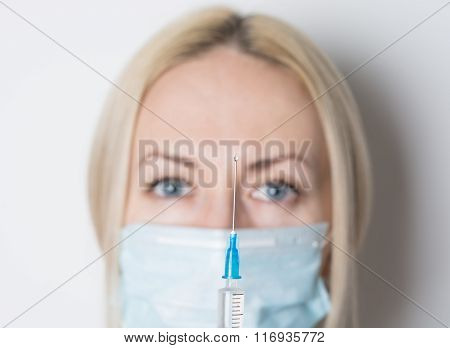 Doctor With Small Syringe