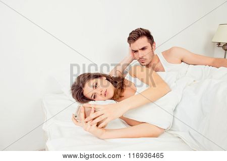 Young Woman Typing Message Ignoring Her Boyfriend