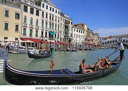 Venice, Italy - September 02, 2012:  Gondolier Rides Gondola On Grand Canal Near The Rialto Bridge I