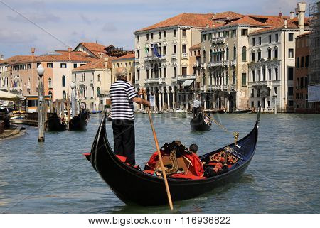 Venice, Italy - September 02, 2012:  Gondolier Rides Gondola On Grand Canal In Venice