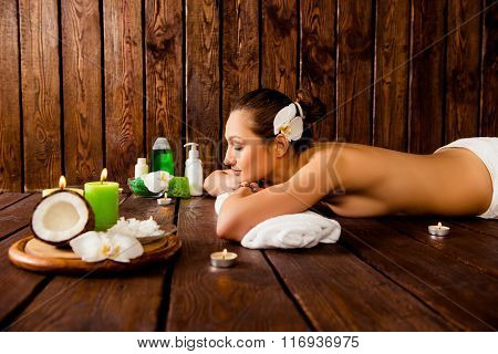 Side View Photo Of Attrative Young Girl  Relaxing In Spa Salon