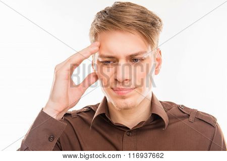 Attractive Young Man With Migraine Touching His Head