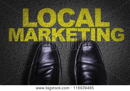 Top View of Business Shoes on the floor with the text: Local Marketing