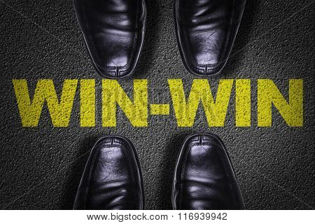 Top View of Business Shoes on the floor with the text: Win-Win