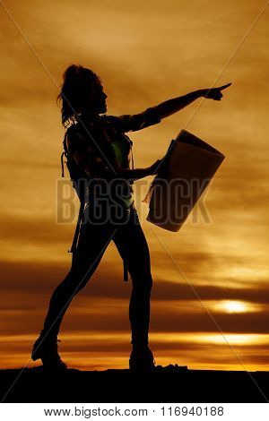 Silhouette Of A Woman Hiker With A Map Pointing